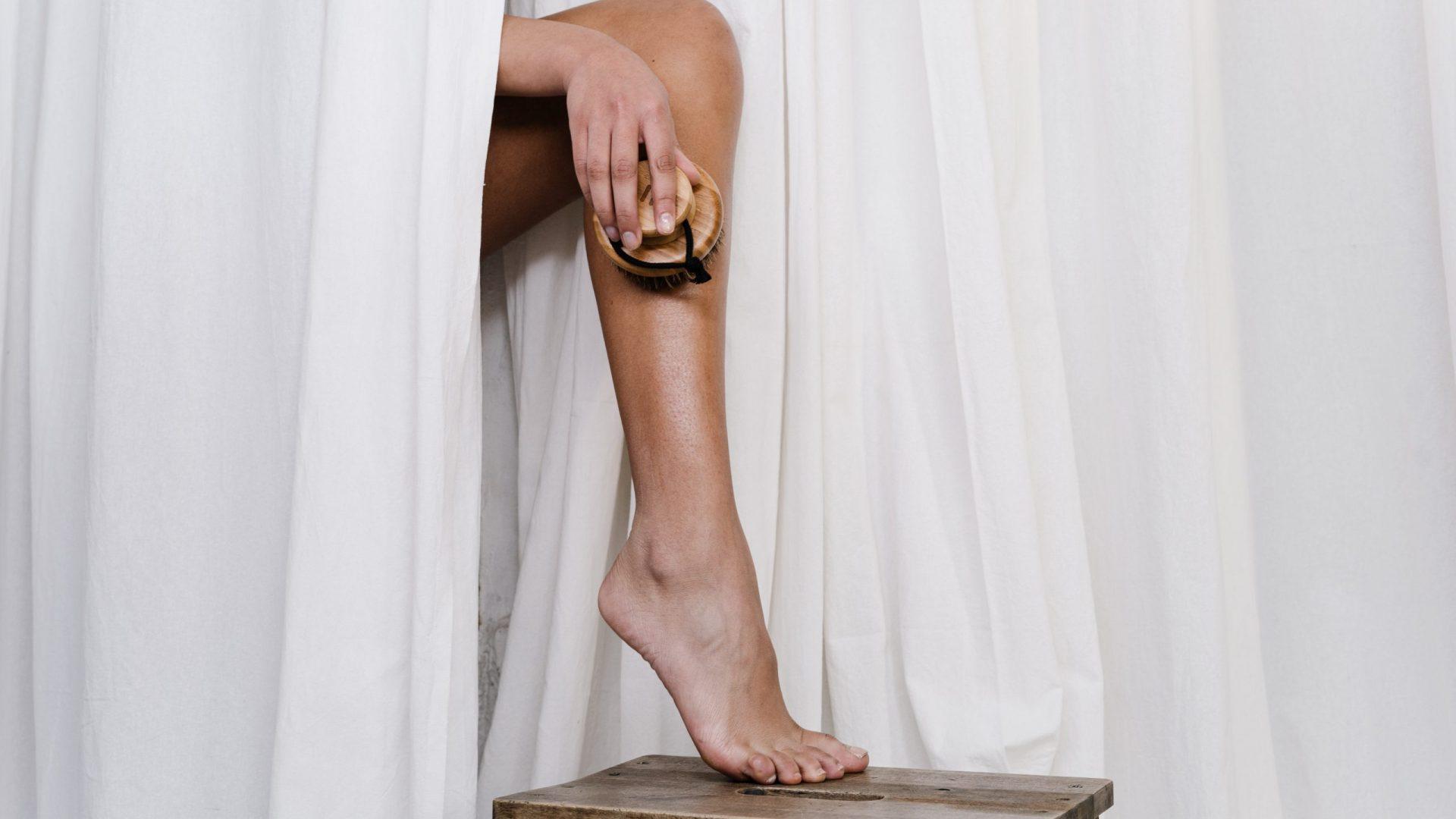 Canva - Person Scrubbing Her Leg